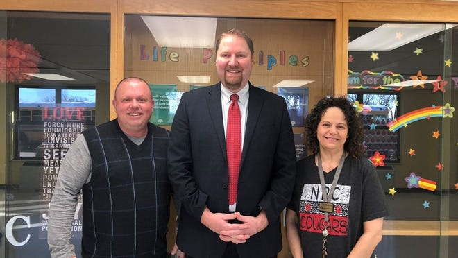 From left to right: David Holland the PFS Coordinator for Gateway to Prevention and Recovery, Blake Moody North Rock Creek School Superintendent and Yevette Marshall the North Rock Creek District Nurse posing together after medical lock boxes were installed in different school sites.