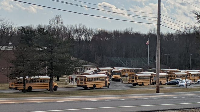 School buses line up outside New Paltz High School on Friday afternoon. Schools in Ulster and Orange counties will be closed for the next two weeks due to the coronavirus, county officials announced on Friday.