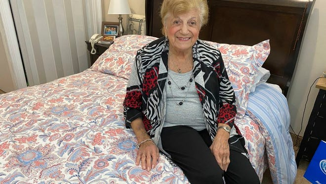 """COVID-19 survivor Anna Fortunato poses for a portrait in her room at The Arbors assisted living community in Jericho, N.Y. on Tuesday, March 31, 2020. Fortunato, 90, says people should keep fighting the new coronavirus and that, """"If I did it, you can do it.""""  For most people, the virus causes mild or moderate symptoms, such as fever and cough that clear up in two to three weeks. For some, especially older adults and people with existing health problems, it can cause more severe illness, including pneumonia and death."""