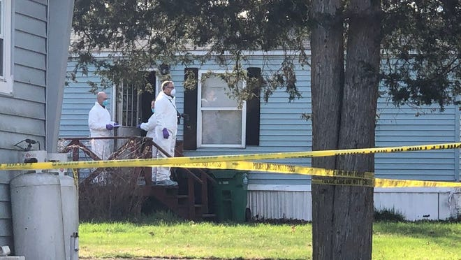 Town of Montgomery police blocked off the area around Robert Frost Lane with police tape as they investigated the deaths of three people inside a home on April 9.