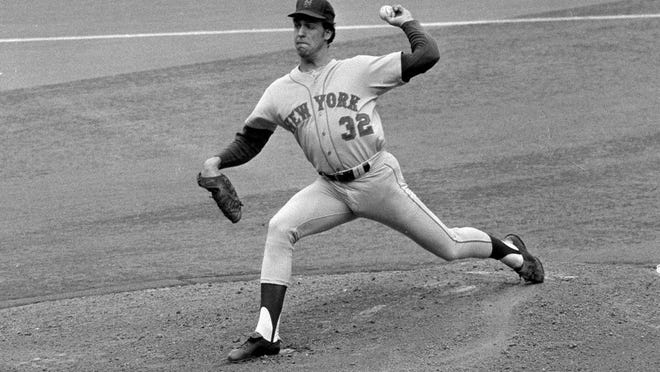 Jon Matlack, New York Mets pitcher, lets go with pitch in game between the Mets Cincinnati Reds at Cincinnati Riverfront stadium in Cincinnati, Oct. 7, 1973. Reds took first in the National League playoffs but Mets came back to swamp the Reds, in the series.