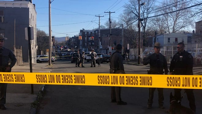 Police at the scene of the shooting in the City of Newburgh on Friday.
