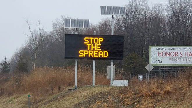 Information signs along Rt. 17 saying stop the spread stay at home. March 20, 2020.