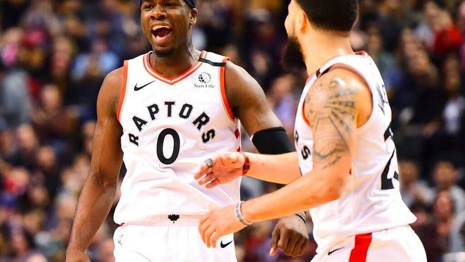 Toronto Raptors guard Terence Davis (0) and teammate Fred VanVleet (23) celebrate a basket during second-half NBA basketball game action against the Chicago Bulls in Toronto, Sunday, Feb. 2, 2020.