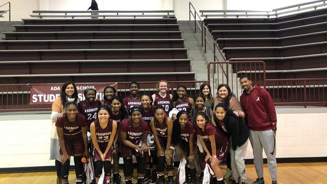 Members of the Ardmore Lady Tigers basketball team pose together after winning the consolation championship Saturday afternoon at the East Central Classic at the Ada Cougar Activity Center.
