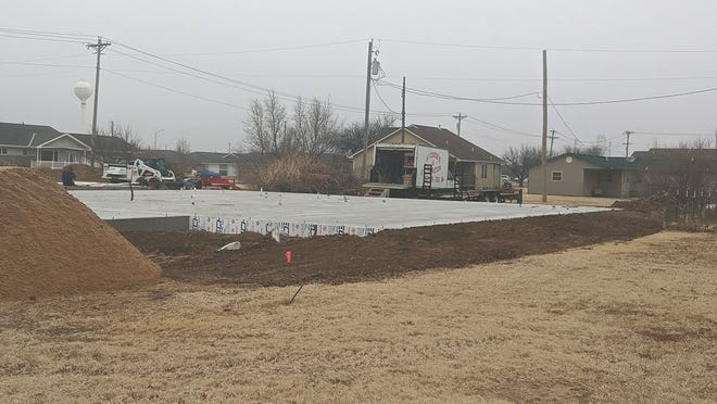 One of two new duplexes is under construction at the corner of Oak and Garfield streets in Greensburg, made possible by a large grant from the state Moderate Income Housing program. Both duplexes should be finished  by August.