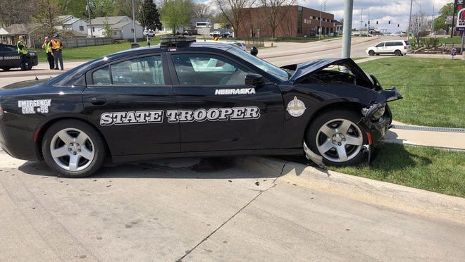 A Nebraska State Patrol cruiser was totaled and the trooper driving it suffered broken bones in a two-vehicle crash in Lincoln April 29.