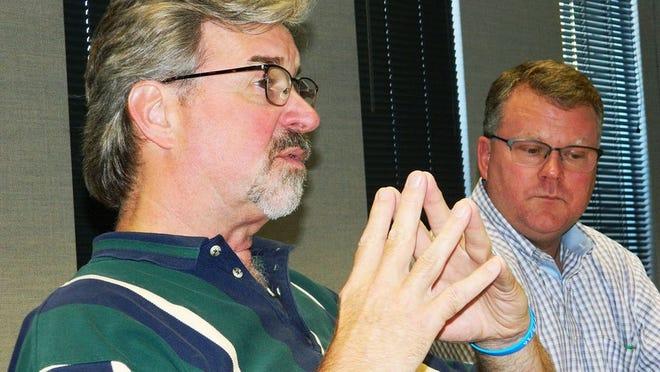 Oak Ridge Community Development Director Wayne Blasius, left, and Oak Ridge Municipal Planning Commission Chairman H. Stephen Whitson discuss the next steps for the Main Street Oak Ridge development.