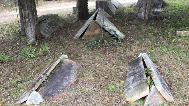 Unusual graves are shown at Yellow Creek cemetery in Cherokee County.