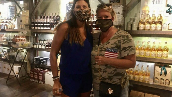 Visitors Jaime Metcalf, left, and Nancy Tucker wear mandatory masks while touring the St. Augustine Distillery on Saturday afternoon.