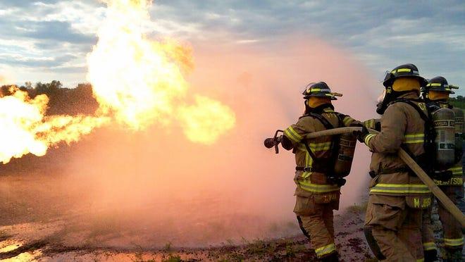 Here, firefighters Trevore Brekken, Matt Johnson and Garett Bengtson work on techniques for battling an LP fire.