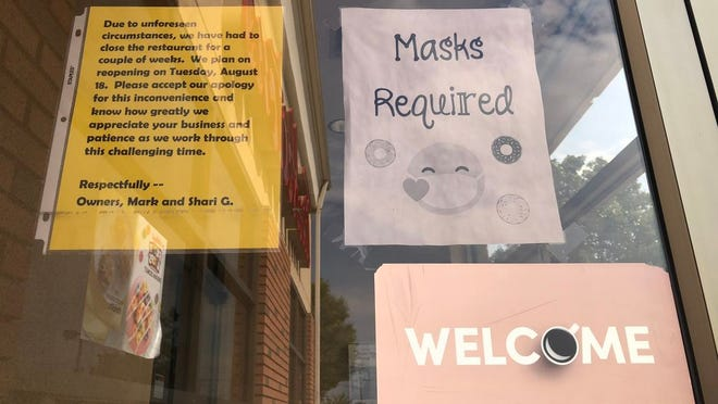 Signs posted on the door of the TIm Horton's on 5137 North Road as a result of three positive cases of COVID-19 being traced to this location. The store will be undergoing a deep cleaning.