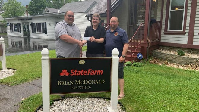 The Bath Volunteer Fire Department recently received a donation of $500 from Brian McDonald, owner of the State Farm Insurance office on Pulteney Square in Bath. Pictured, from left: Chief Matt Glashauser, McDonald and President Jason Causer.