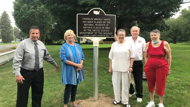 A marker from the National Register of Historic Places is installed at the Hinchey Homestead. Pictured, from left, are Gates Supervisor Cosmo Giunta, Gates Historical Society board member Cindy Hinchey, GHS President Susan Swanton, Gates Historian William Gillette and GHS Past President Virginia Paddock.