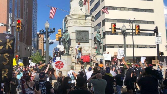 Protester gather in Allentown, Pa., on Monday to express outrage and press their demand for accountability after video emerged of an officer placing his knee on a man's head and neck area outside a hospital. Police have launched an internal probe.