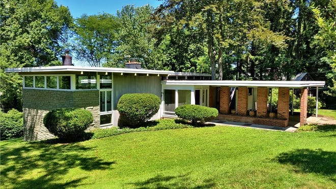 This unique home at 330 Hilltop Road in Erie blends a lot of glass, brick and stone into its construction. It is listed at $269,000.