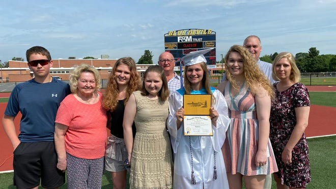 Emma Strait joined her family for sister Kristen True's graduation from Greencastle-Antrim High School. From left: cousin Brady Shiflet, grandmother Carol Smith, sister Ellie Strait, Emma, Kristen, sister Ashley True and mother Missy True. Back: grandfather Leon Smith and stepfather Jay True. SHAWN HARDY/ECHO PILOT