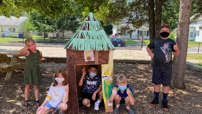 Students in Delaware City Schools' School Age Child Care program pose next to a house they designed, built and decorated. The 2020 program restarted July 6 with safety precautions in place for the COVID-19 coronavirus pandemic.