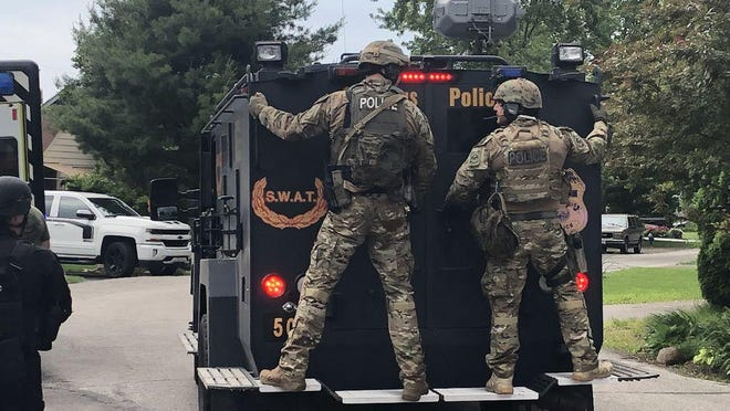 Columbus Division of Police SWAT team members arriving on the scene of a barricade situation.