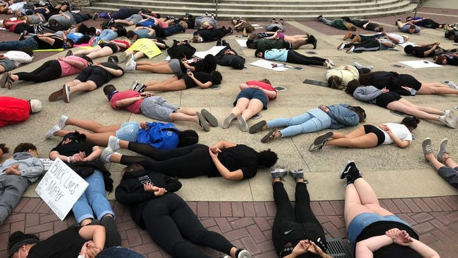 Demonstrators lie prone and silent on June 1 at Hilliard's Station Park, 4021 Main St., to evoke the amount of time -- almost nine minutes -- and the position in which 46-year-old George Floyd lay when he died May 25 in the custody of a Minneapolis police officer.