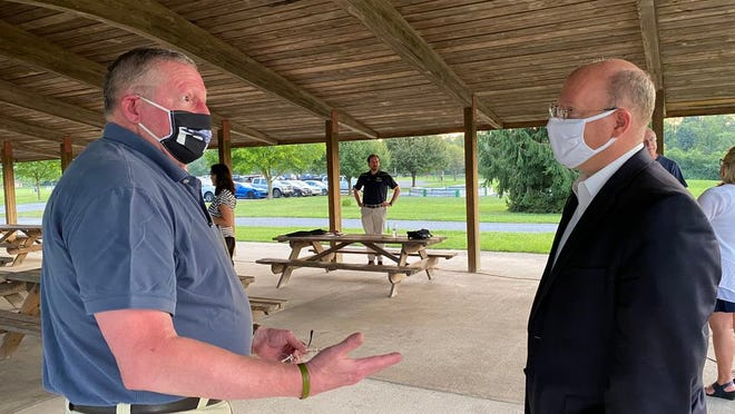 Chris Richwine of Waynesboro talked with state Rep. Paul Schemel after Tuesday evening's town hall in a pavilion at Antrim Township Community Park. SHAWN HARDY/ECHO PILOT
