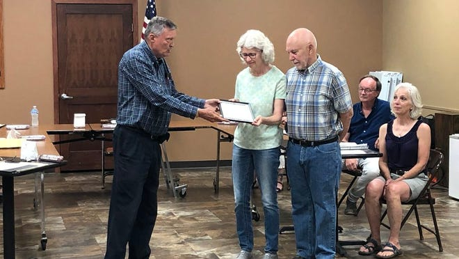 """Mayor Gary Sturm presents James and Evelyn Hermoe with the """"Good Neighbor Award"""" at the start of the St. James City Council meeting on Tuesday night."""