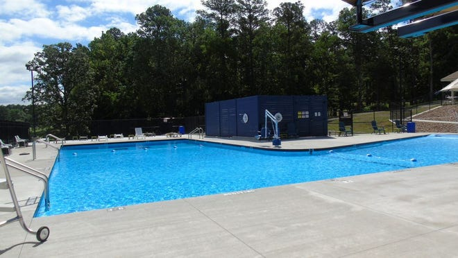 Shade shelters and spray jets are among pool's features.