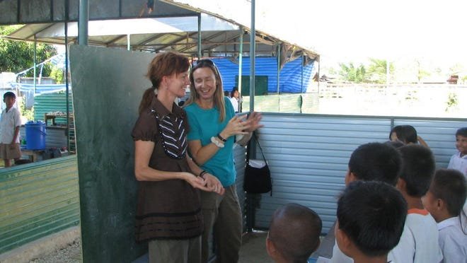 Patti Dillon teaches English to a group of young students in Cambodia.