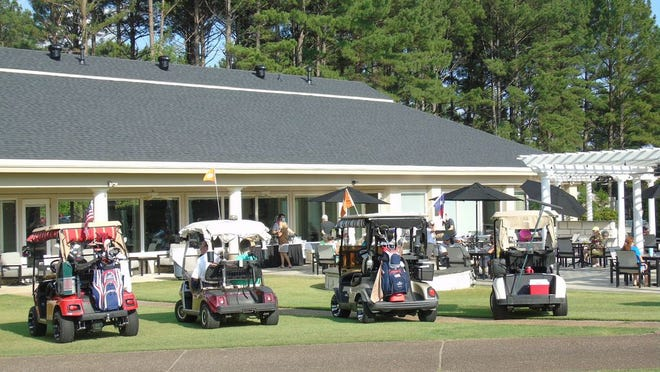 Many golf cars surrounded the front lawn at Diamante.