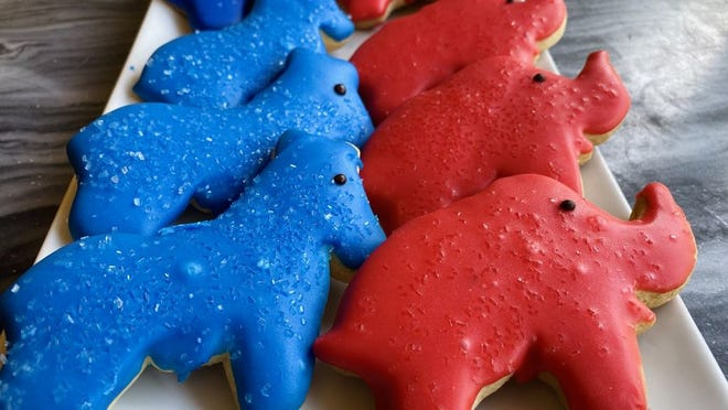 Mozart's, 4784 N. High St., is offering $1.99 cookies in Republican red and Democratic blue. The informal poll was introduced in 2000.