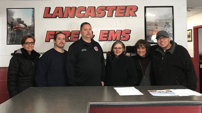 The Lancaster Fire Department will receive a $2,500 grant from Georgia-Pacific for new equipment. Pictured are, from left, Georgia-Pacific's Cheryl Molebash, Lancaster Fire's Michael Hanson and Courtney Manning, GP's Julia Connery and Samantha Wood, and Lancaster FD's Jonathan Stadnicki-Verhyen.
