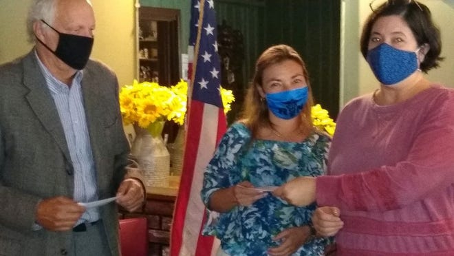 From left, Naples Rotary Club members Tom Pawluk, Jennifer Emmons and Jodie Simons-Caruso