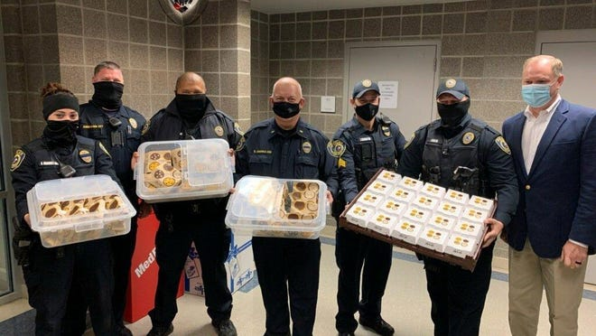 Pflugerville first responders were treated to a breakfast of baked goods on Wednesday at police headquarters courtesy of McDonald's, which is owned by retired Army Capt. Bill Cross. The event took place on National First Responders Day. From left are officer Amanda Maddera, Sgt. Nathan Arnhamn, officer Reynaldo Gonzales, Lt. Chet Vronka, Sgt. James Colligan, officer Ian Clark and Cross.