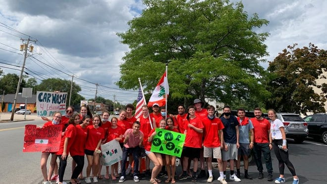 Cynthia Metri,17, and a group of her and her brothers' friends, gathered with homemade posters on Wednesday in Weymouth to attract drivers to their car wash in support of victims of the Beirut, Lebanon explosions.