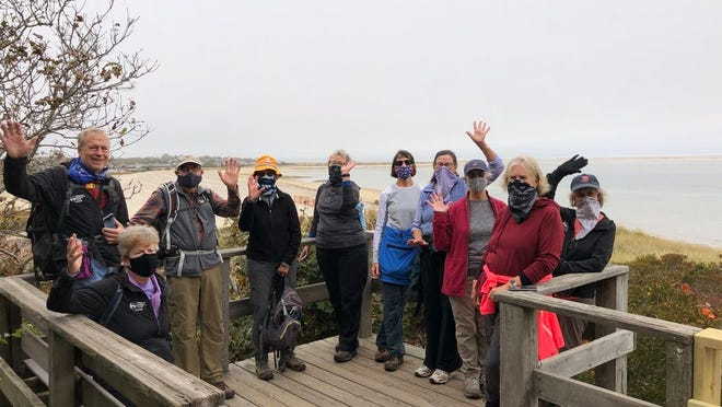 A happy group of hikers at the Monomoy National Wildlife Refuge in Chatham after walking around Morris Island.