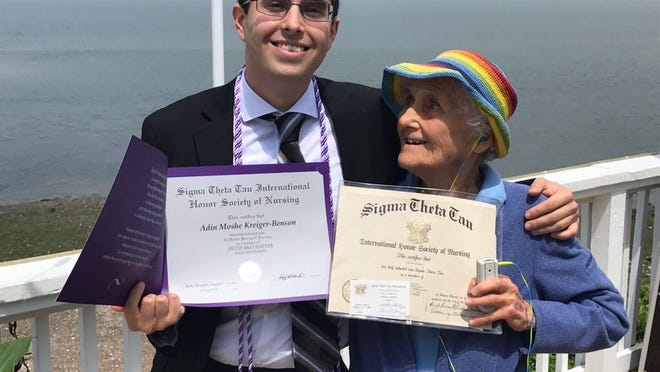 Evelyn Rose Benson, 96, of Brookline proudly displays her Sigma Theta Tau (international nursing honor society) certificate along with her grandson Adin Moshe Kreiger-Benson, holding his certificate. Adin became a Family Nurse Practitioner this year and credits his grandmother for inspiring him to join the nursing profession.