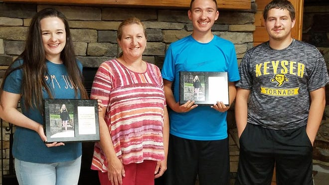 Scholarship recipients are congratulated by Sara Janene Powell's family. Pictured are: (l-r) Molly Kephart, Sheila Powell (Sara's mother), Eli Kesner, and Hunter Powell (Sara's brother).