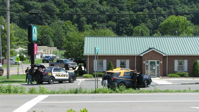Area law enforcement stage outside the Chessie Federal Credit Union in Keyser as a woman held three tellers and two customers hostage inside.