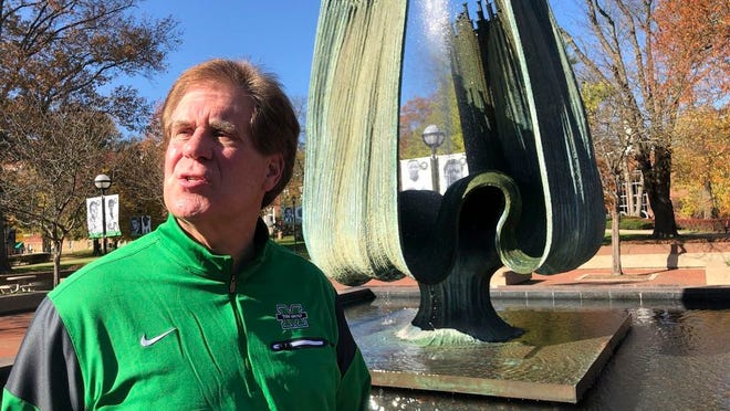 Marshall University athletic director Mike Hamrick speaks next to the Memorial Fountain on the school's campus in Huntington, W.Va., Saturday, Nov. 7, 2020. The fountain is dedicated to the memory of 75 people killed in a Nov. 14, 1970, plane crash. Among the victims were 36 Marshall football players.