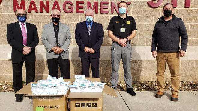 Mineral County Commissioners Richard Lechliter, Roger Leatherman and Jerry Whisner; along with Luke McKenzie, director of Mineral County Emergency Services, accept a donation of face masks from Doug Vance, plant manager, Pinnacle Wind Farm.