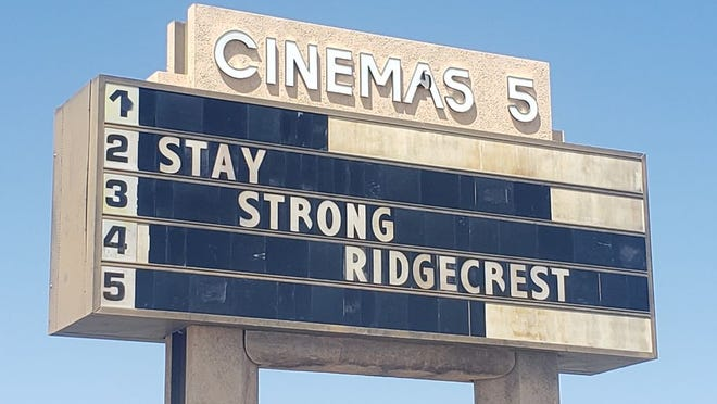 The marquee sign at Ridgecrest Cinemas urges the community to stay strong in this April 2020 file photo. The theater has announced that the Ridgecrest farmers' market will be moving to its parking lot next weekend, opening on Aug. 22 at 8 a.m.