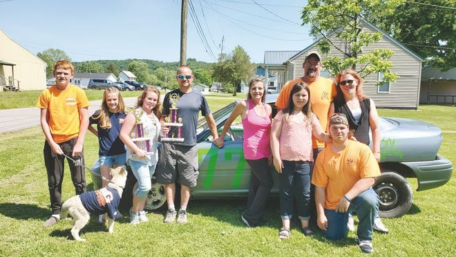Pictured from left to right are sponsors B&G Heating and Cooling representatives Parker Cobb and Emry Cobb; hood and main car sponsor Danielle Little, owner of Maid for A Day; driver Kris Skeen (holding hands with his wife) Jay White; sponsor Shaun Myers with daughter Makenzie Myers, owners of S&M Lawncare; Carrie Myers and son Shaun Myers, owners of Myers Rabbitry. Sponsors not pictured include: Amanda Smith, owner of Fat Albert's Pizza; Kathryn Kit Hoffman LLC Real Estate, Ken and Phyllis Skeen, driver's parents; and Annie and Zach Barnes, family.