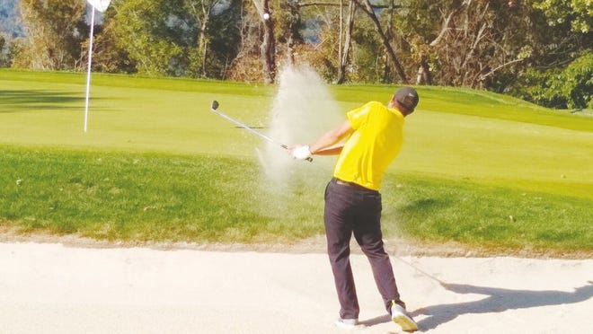 Ravenswood's own Alex Easthom takes a shot from the bunker at a recent tournament.