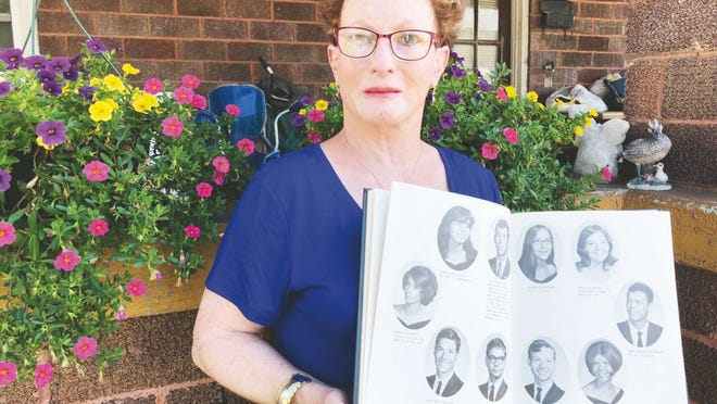 Sandra Bailey Summers reminisces with the yearbook from 1971.
