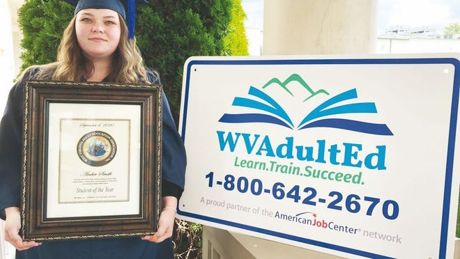 Amber Smith proudly wears her graduation cap and gown as a recent recipient of her high school equivalency diploma.