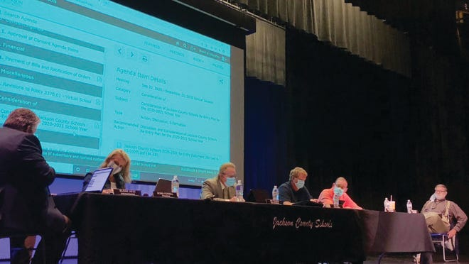 The Jackson County Board of Education held a special meeting on Tuesday evening, Sept. 22, to discuss the school re-entry plan. Board members social distanced while utilizing the stage at the Ripley High auditorium.