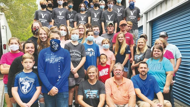 Members of the Ripley chapter of FFA and Ripley High boys soccer team load over 10,000 shoes for Christian Laced and Soles4Souls.
