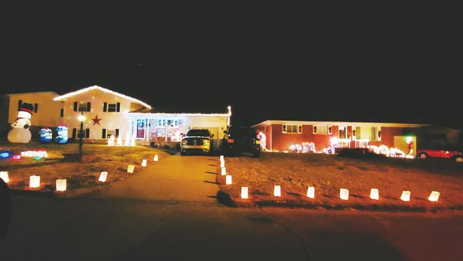 Luminaries from December 2019 light the driveways of homes around Ravenswood.