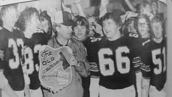 Fred Taylor is pictured following the 1975 Hatchet win. He is surrounded by Jeff Stefanov, Gary Blair, Greg Davis, and Bryan Canterbury.
