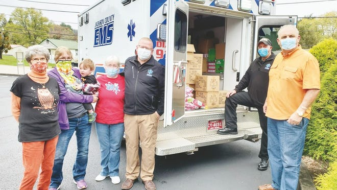 The Sandyville Senior Center supports the local Toys-for-Tots program each year. Pictured from left to right are Janice Anderson, Cindy Burke (holding her grandson Gavin), Joyce Thompson, Jackson County EMS director Troy Bain, Shawn Mckenna, and Jackson County Commissioner Mitch Morrison.